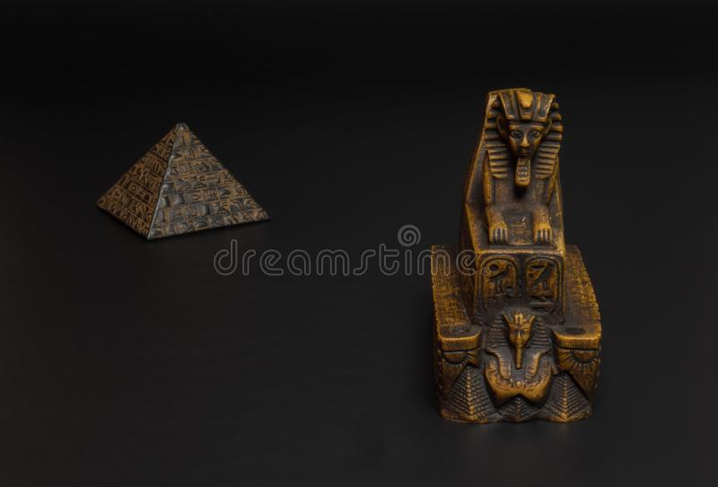 Sphinx and pyramid statuette stock photo