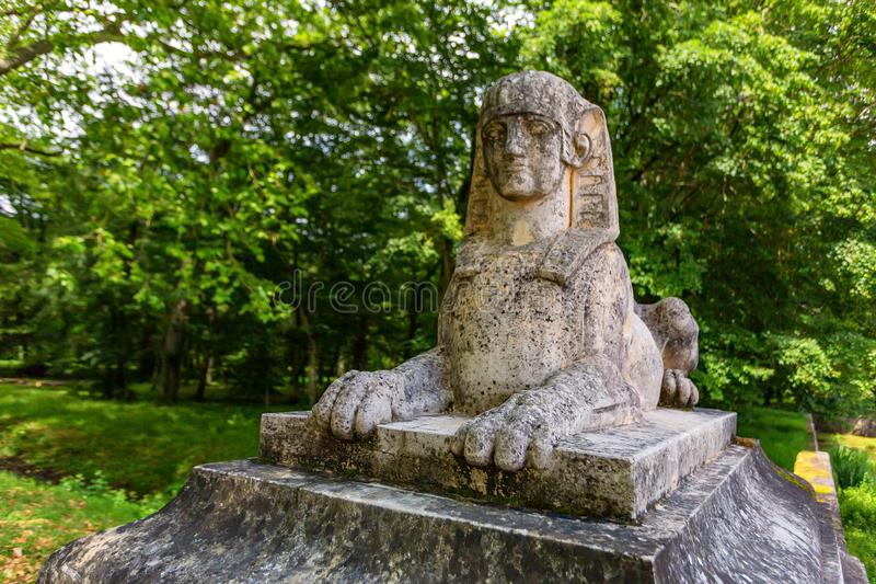 Sphinx statue in park near Chateau de Blois. Close up stone Sphinx in green park outside medieval French castle of Blois stock photography