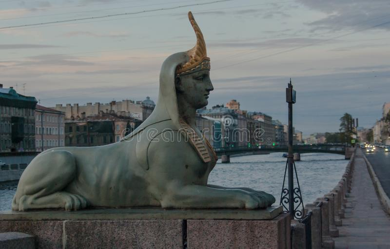 Sphinxes on the Egyptian bridge. Egyptian bridge 1826 chain, 1955 metal — a bridge over the Fontanka river in the Admiralty district of St. Petersburg royalty free stock photos