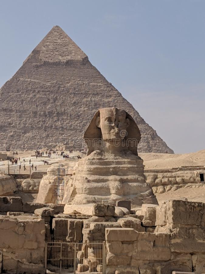 Sphinxs with the pyramid in the background stock images