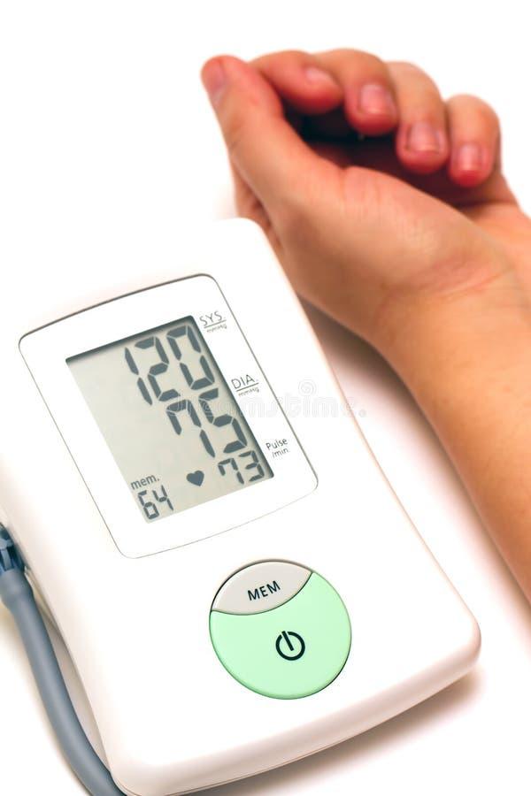 Sphygmomanometer And Arm Stock Photography