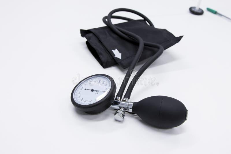 Blood pressure cuff. Sphygmomanometer or blood-pressure cuff on a white background stock image