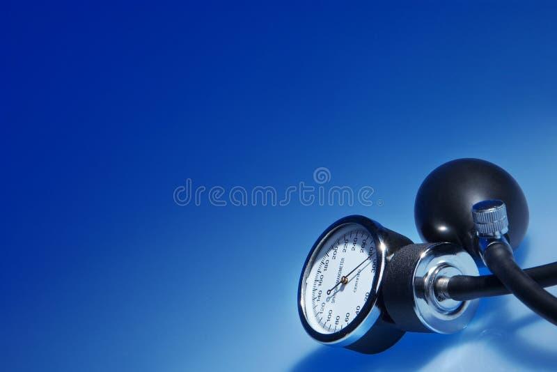 Download Sphygmomanometer On Blue Background Stock Photo - Image of health, desease: 27384718