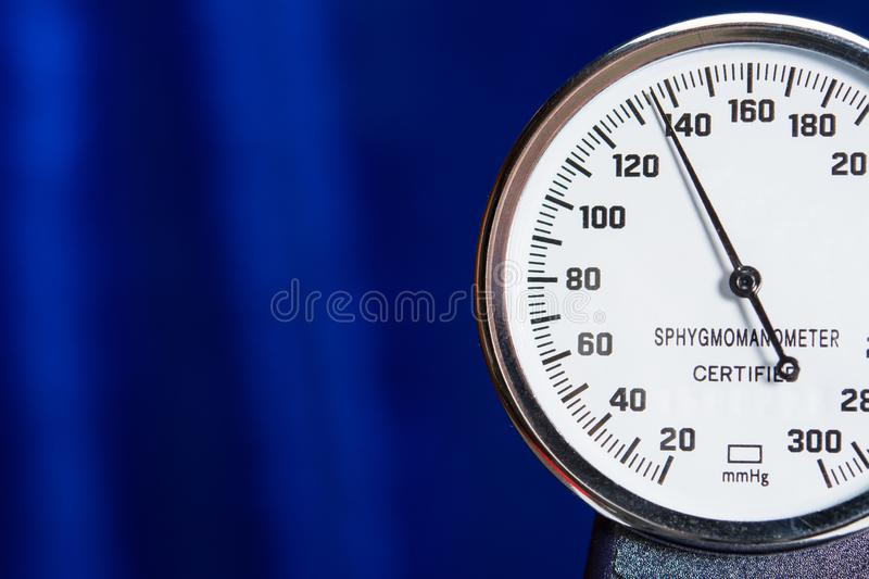 Sphygmomanometer closeup blood pressure measurment medical equipment. Tonometer, part of medical tool on blue background. Close-up high resolution royalty free stock photography