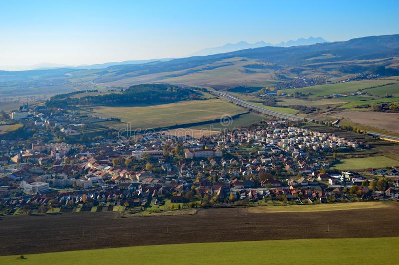 Spišské Podhradie and Slovak Countryside in the Presov region. View over Spišské Podhradie from Spis Castle and Beautiful rolling fields and hills in royalty free stock photos