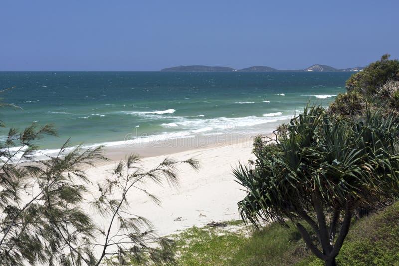 Spiaggia dell'arcobaleno nel Queensland fotografia stock libera da diritti
