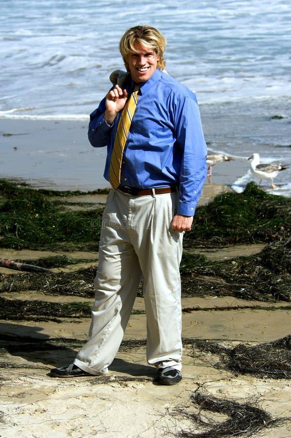 Spiaggia dell'uomo di affari fotografie stock