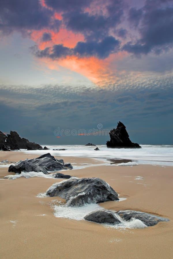 Spiaggia di Adraga al tramonto immagine stock