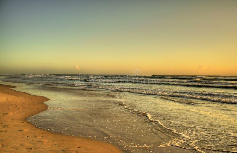 Spiaggia di alba fotografie stock