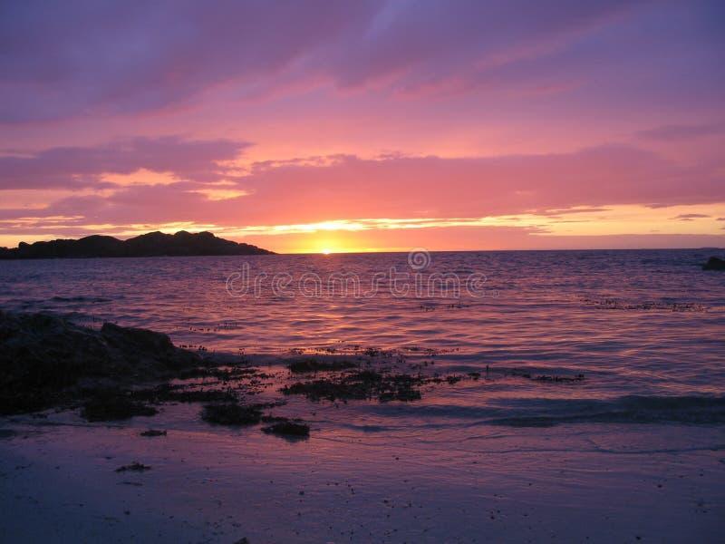 Spiaggia di Iona al tramonto immagini stock