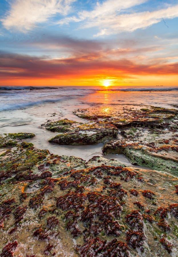 Spiaggia di tramonto fotografia stock
