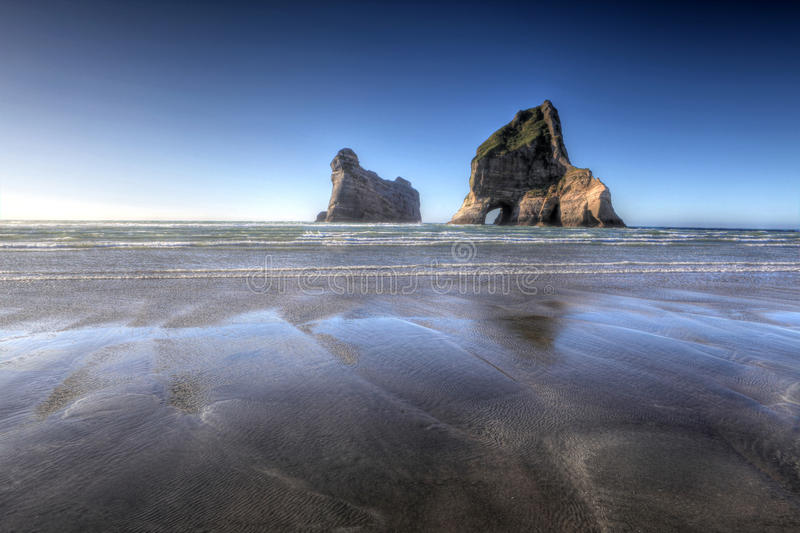 Spiaggia di Wharariki fotografie stock libere da diritti