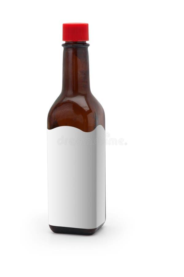 Spice бутылка соуса с пустой биркой на белизне стоковые фотографии rf