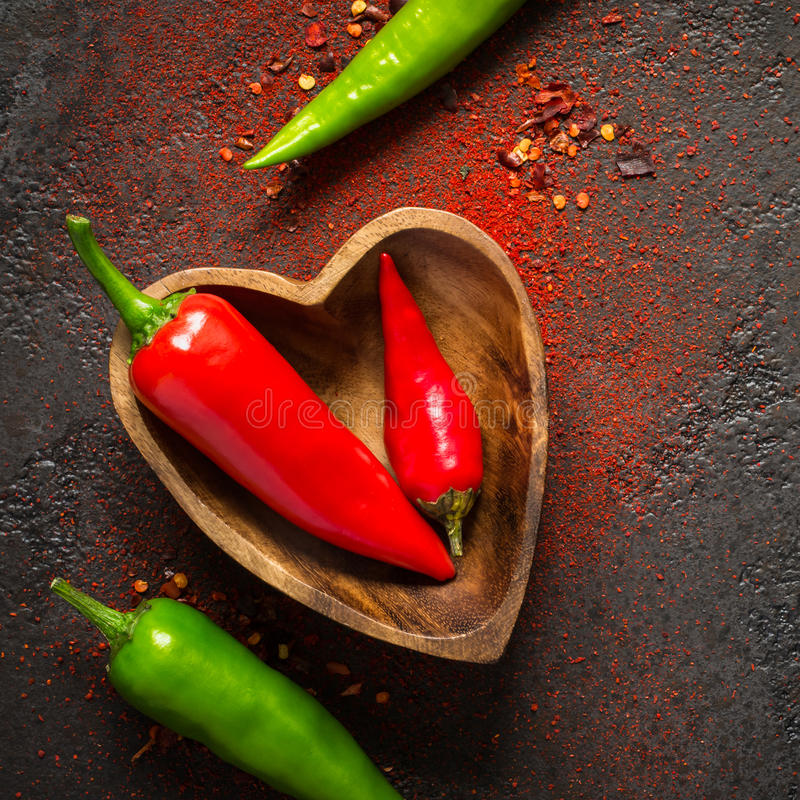 Spice Food Background. Red And green hot pepper in a wooden bowl.  stock photography