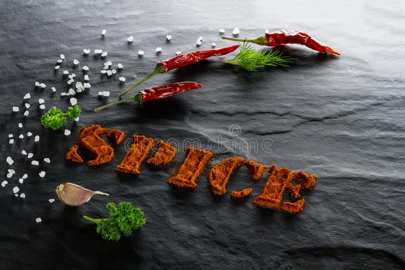 Spice. Ground paprika, chili pepper, garlic, parsley, dill and sea salt close up stock photo