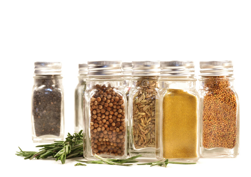 Download Spice Jars With Fresh Rosemary Leaves Against White Stock Photo - Image: 9039068