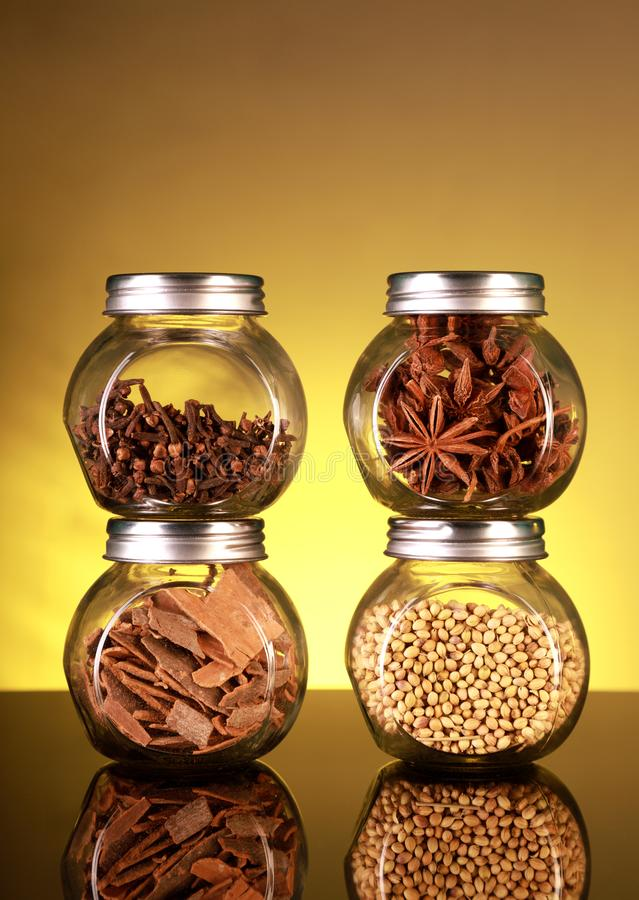 Spice Jars with Star Anise, Cloves, Cinnamon, Coriander Seeds stock photo