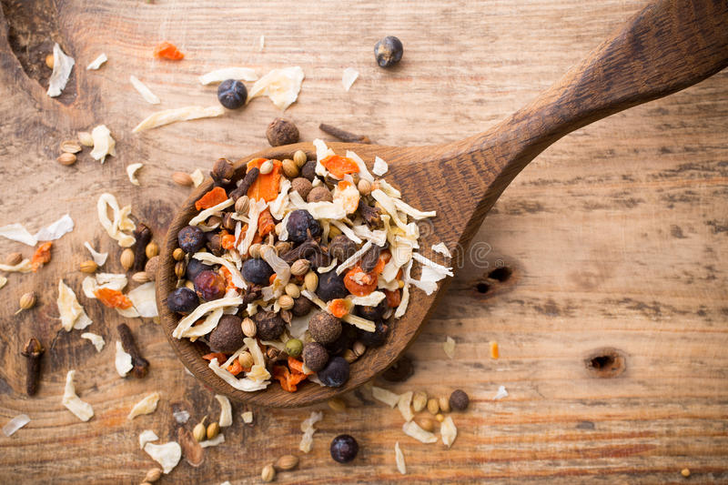 Spice. Spice mix a wooden spoon on a wooden background royalty free stock images