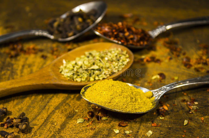Spice one. Spoon yellow spices food kitchen stock images
