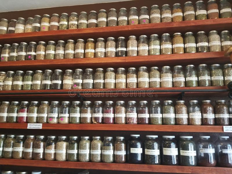 Spice rack full of spices stock photography