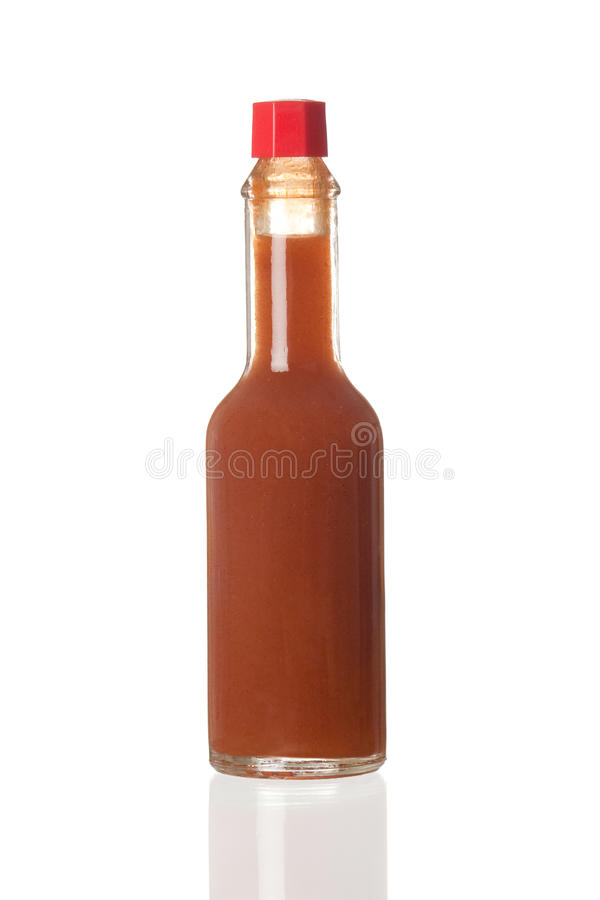 Spice sauce boat. On white background with reflection royalty free stock photo