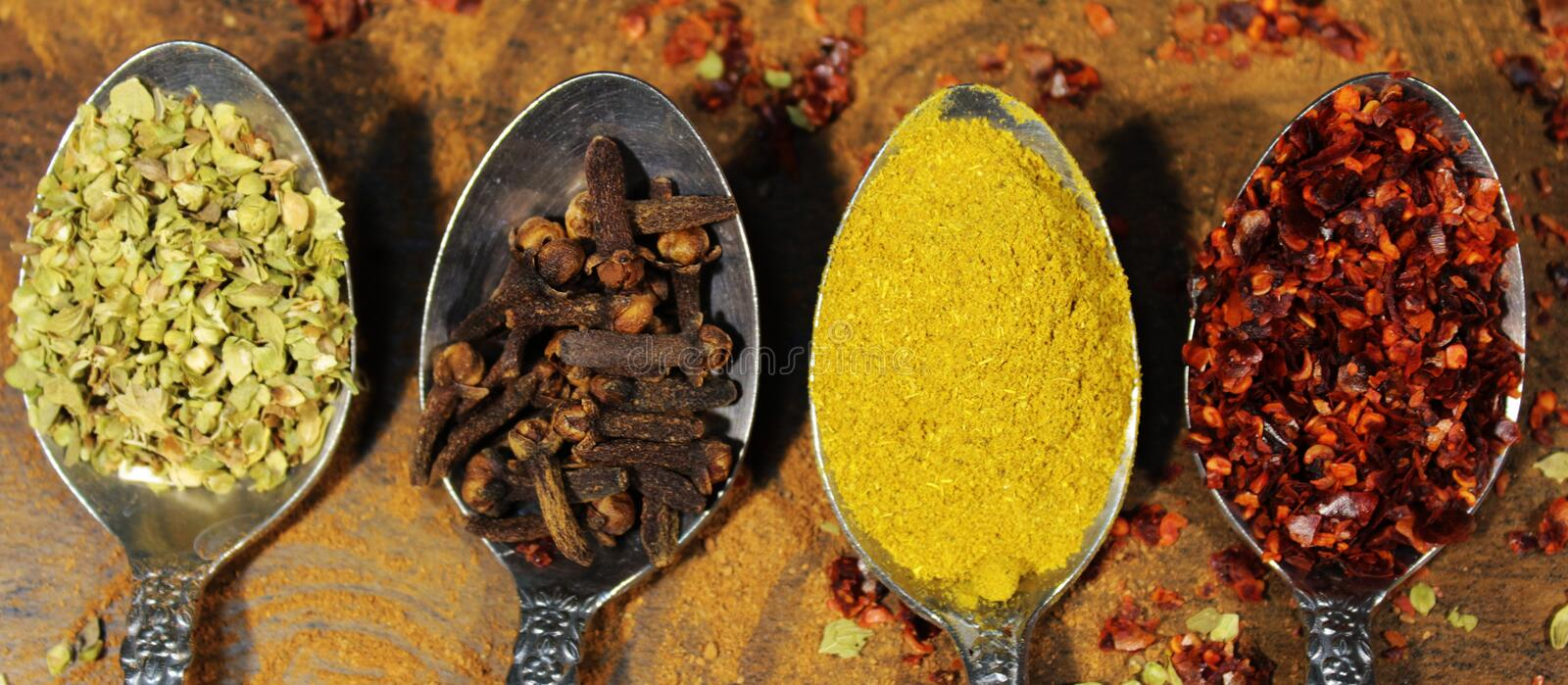 Spice spoon. Spoon yellow spices food kitchen royalty free stock photos