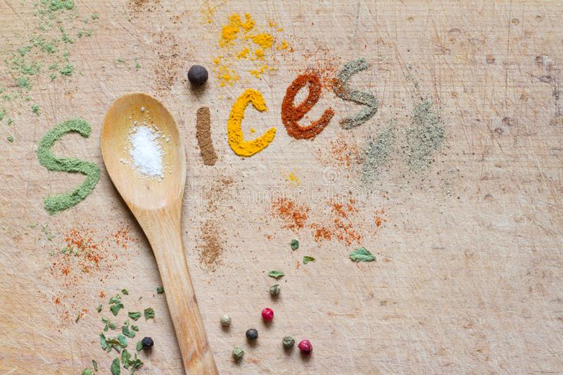 Spice text made with spice mix and spoon stock photos
