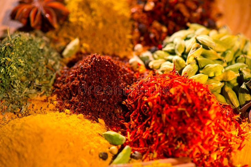 Spice. Various indian spices and herbs colorful background. Assortment of seasonings stock image