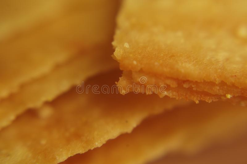 Spiced Homemade Potato Chips. Macro shooting chips. Very close up. Chips from the oven only, rosy chips, chips with cheese, bacon. stock images