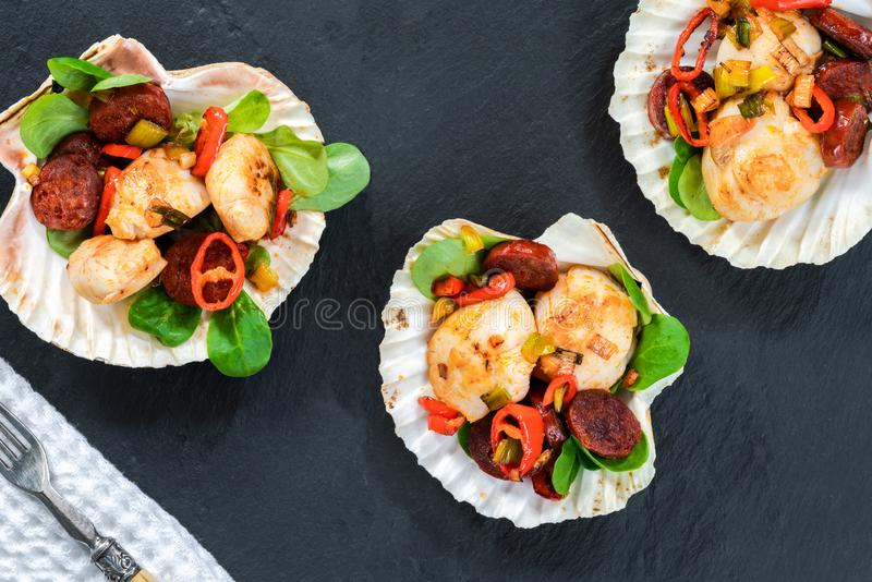 Spiced scallops with chorizo stock images