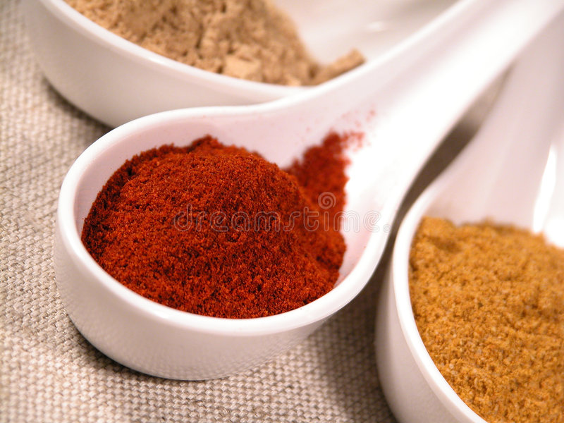 Spices. On spoons stock photos