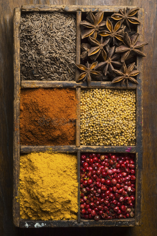 Spices. Diverse spices in a wooden box (peppers, star anise, cummin, mustard seed