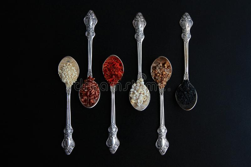Spices in antique spoons royalty free stock photography