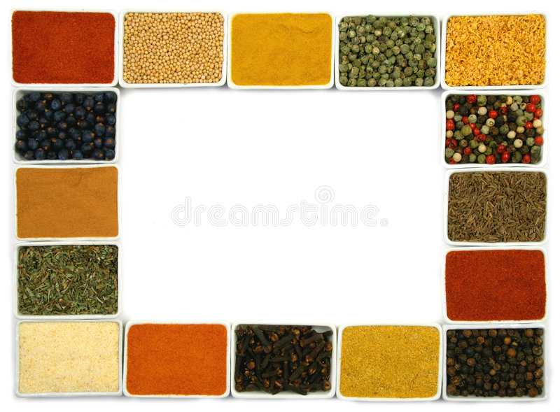 Spices border. Colorful spices in rectangular ceramic containers - beautiful kitchen frame royalty free stock image