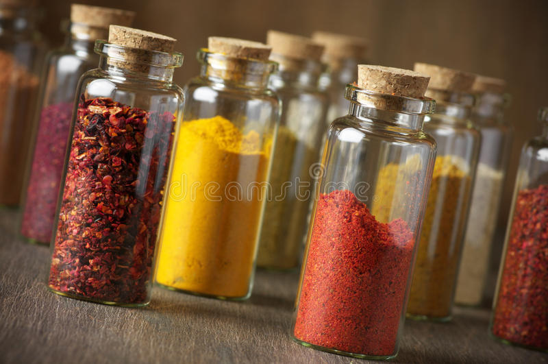 Spices in bottles royalty free stock photos