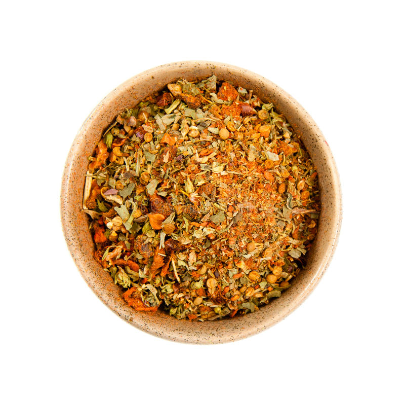 Spices in a ceramic bowl. Exotic spices in a ceramic bowl isolated on white stock images