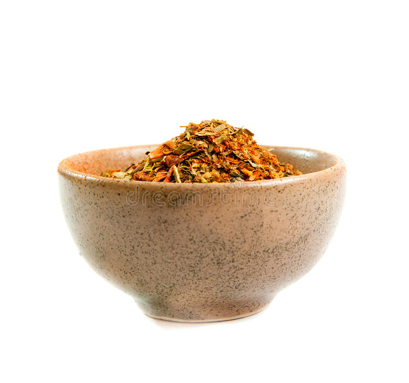 Spices in a ceramic bowl. Exotic spices in a ceramic bowl isolated on white royalty free stock photo
