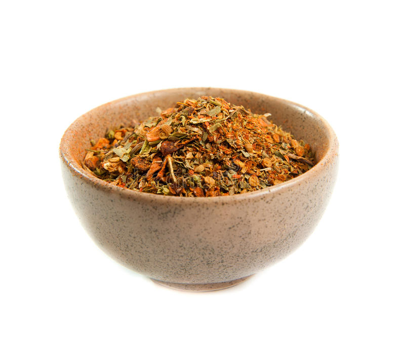 Spices in a ceramic bowl. Exotic spices in a ceramic bowl isolated on white stock photography
