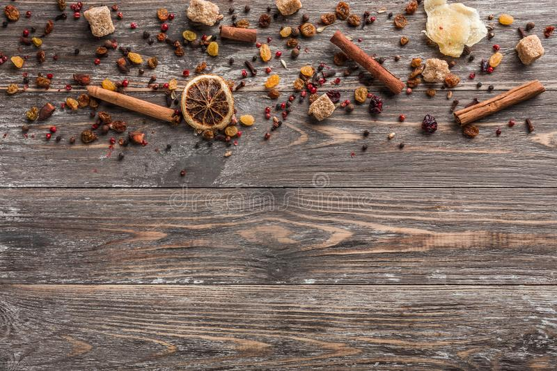 Spices, cinnamon and dried fruits for the preparation of the wine drink royalty free stock image