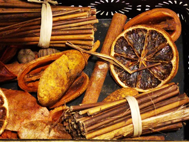Spices cinnamon and slices of dried oranges stock image