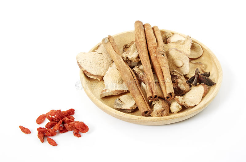 Spices. Cinnamon, star anise, cardamom, galangal, on a white background royalty free stock image