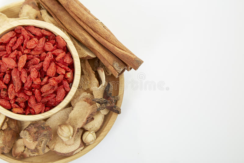 Spices. Cinnamon, star anise, cardamom, galangal, on a white background royalty free stock images