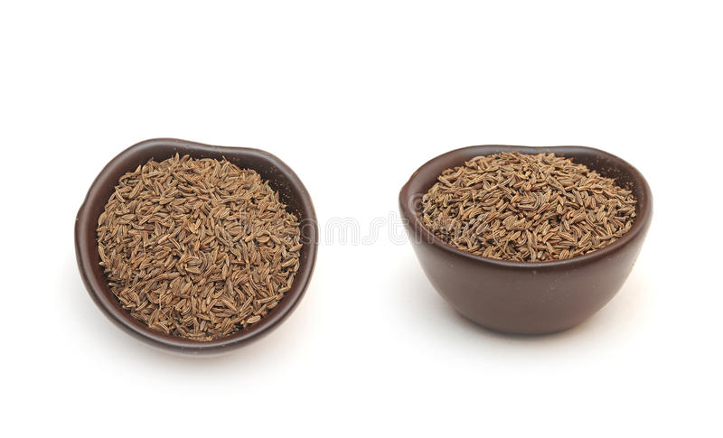 Spices cumin seeds in a clay bowl stock images