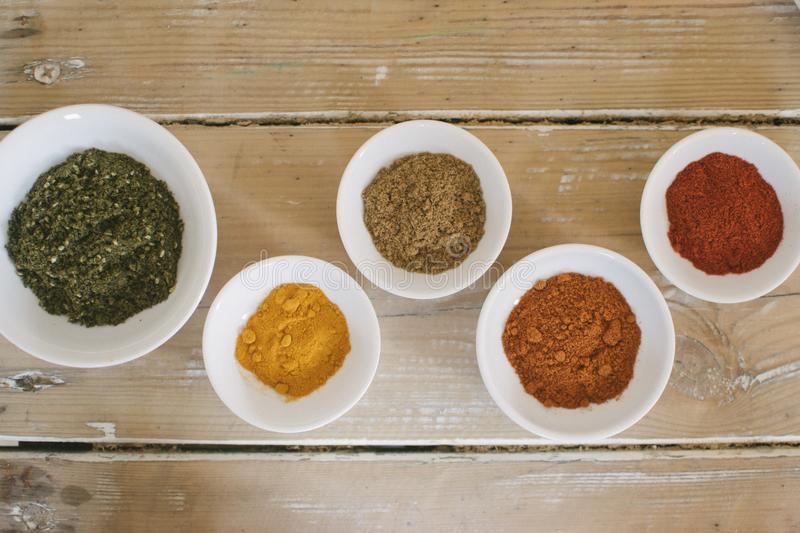 Spices in a dishes royalty free stock photography
