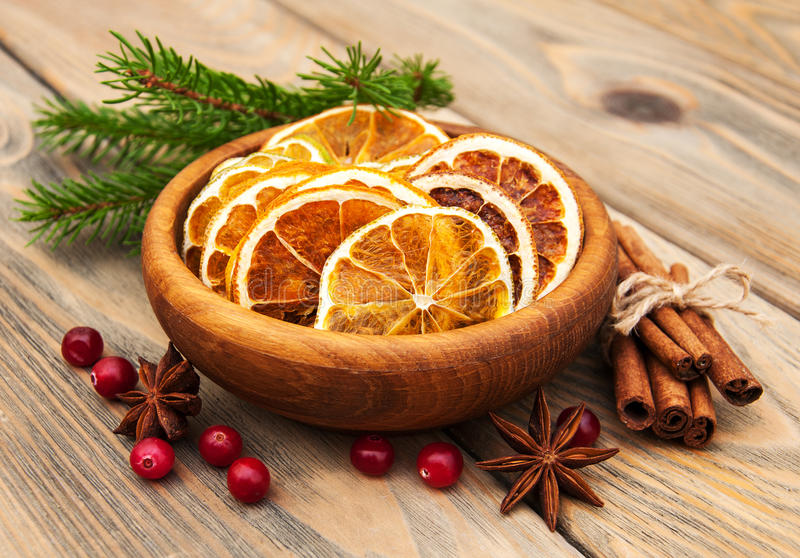 Spices and dried oranges stock photography