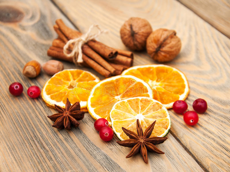 Spices and dried oranges stock photo