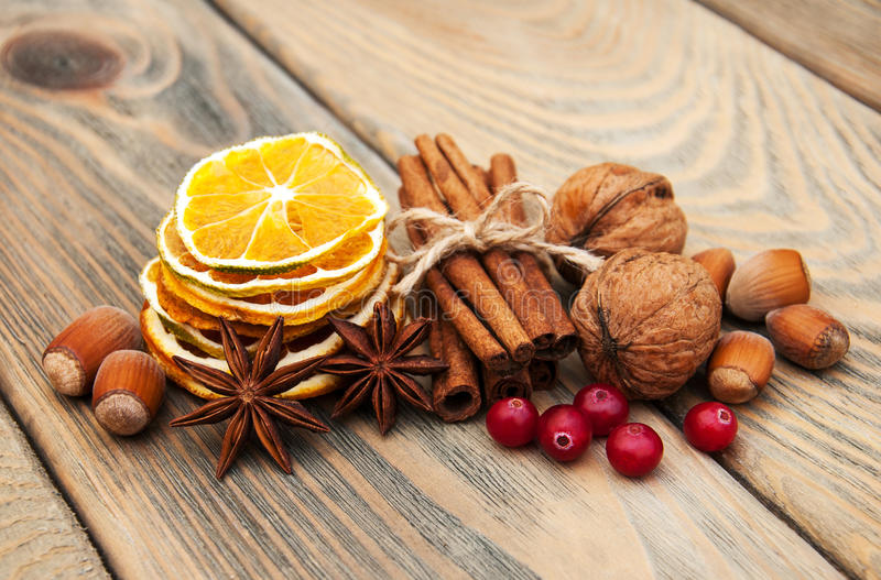 Spices and dried oranges stock images