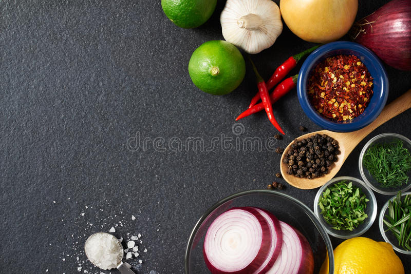 Spices and Food Ingredients on Slate Background royalty free stock image