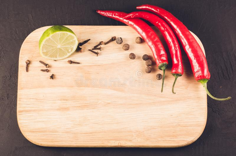spices, fresh ingredients and empty cutting board/spices, fresh ingredients and empty cutting board. Top view. Copy space royalty free stock photo