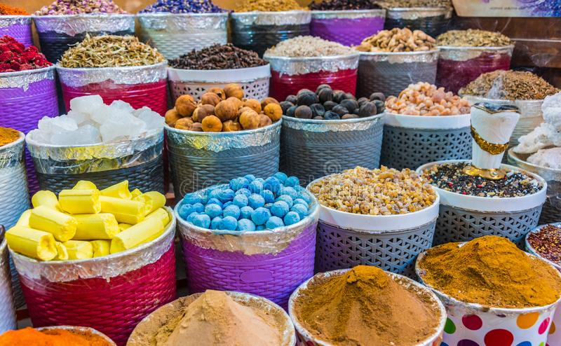 Spices and herbs on the arab street market stall. Variety of spices and herbs on the arab street market stall. Dubai Spice Souk, United Arab Emirates royalty free stock images